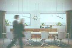 White and wooden meeting room interior people. Modern conference room interior with a concrete floor, white walls and a long table with white chairs. Business Stock Images