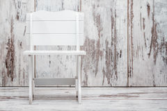 White Wooden Miniature Bench on White Wooden Background stock image