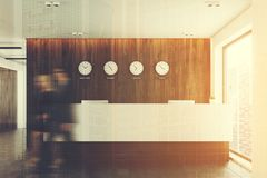 Reception table and world time clocks double Royalty Free Stock Photos