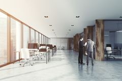 White and wooden open space office, people Royalty Free Stock Photo