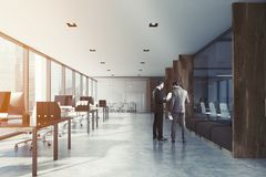 White and wooden open space office toned. White open space office interior with aquarium like rooms, wooden columns and a row of computer desks along the wall Royalty Free Stock Photography