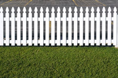 White wooden picket fence stock images