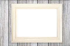 White wooden picture frame on wood wall Royalty Free Stock Photography