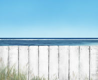 White Wooden Plank Fence on Beach Stock Photography