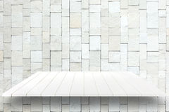 White wooden plank shelves and white Stone Wall background. For product display Royalty Free Stock Image
