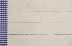 White wooden planks with checkered tablecloth Stock Image