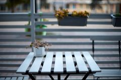 White wooden planks table, chairs and horizontal fence of cafe in the street. Background for product placement. Isolated Royalty Free Stock Photography