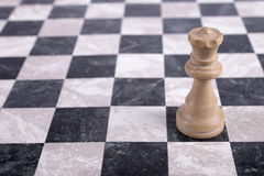 White wooden queen on chessboard. White wooden queen standing on chessboard Stock Photos