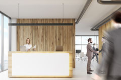 White and wooden reception, business people Stock Photography