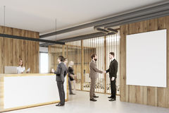 White and wooden reception, meeting room people Royalty Free Stock Images