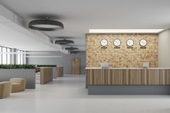 White and wooden reception. Lobby with a concrete floor, two computers on it, flower beds with grass and round ceiling lamps. 3d rendering mock up Royalty Free Stock Photos