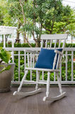 White wooden rocking chair on front porch. At home Royalty Free Stock Photo