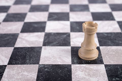 White wooden rook on chessboard Royalty Free Stock Photo