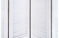 White wooden screen for changing clothes with a texture for the background. Horizontal frame Stock Photography