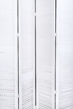 White wooden screen for changing clothes with a texture for the background. Vertical frame Stock Images