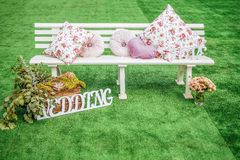 White wooden seat decorated for wedding Stock Photos