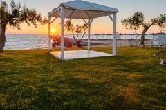 White wooden shed. At seashore during sunrise Stock Images