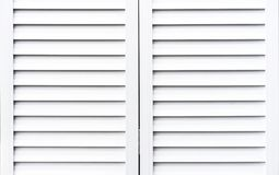 White wooden shutters to protect windows from sunlight royalty free stock image