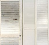White Wooden Shutters on the Wall royalty free stock photo