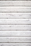 White wooden siding. White washed wooden siding that is distressed with chipped paint stock photo