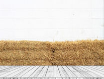 White wooden stair perspective Against the backdrop straw and white walls. Stock Photography