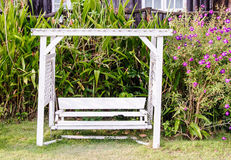White wooden swing Stock Photos