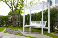 White wooden swing. In outdoor park Stock Photography