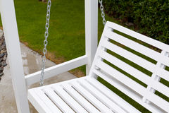 White wooden swing. In outdoor park Stock Image