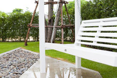 White wooden swing. In outdoor park Stock Photo