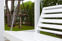 White wooden swing. In outdoor park Royalty Free Stock Photo