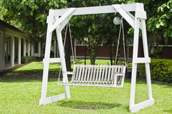 White wooden swing. Stock Images