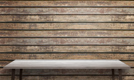 White wooden table with black legs. Wooden wall texture in background Royalty Free Stock Photo