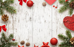 White wooden table with christmas tree and decorations top view. Free space for text. Christmas balls, bow, walnut, pincone, stars and gift beside royalty free stock images