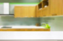 White wooden table with kitchen interior Stock Photo