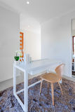 White wooden table and light wooden chair in the modern room Royalty Free Stock Photos