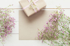 White wooden table with pink flowers and a present, mother`s day. Concept Royalty Free Stock Photos