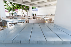 White wooden table with restaurant on background. Out of focus Royalty Free Stock Images