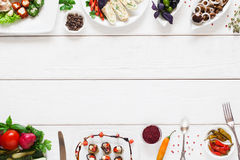 White wooden table with traditional food frame royalty free stock images