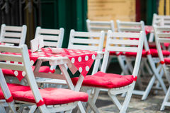 White wooden tables with chairs at summer open air cafe terrace. View of empty outdoor cafe in Europe. Royalty Free Stock Image