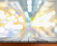 White wooden tabletop under blurred of picture people Royalty Free Stock Photos