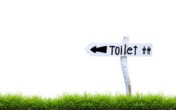 White wooden toilet sign with green grass. Isolated on white background Royalty Free Stock Photo