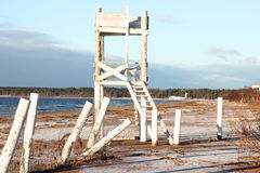 White wooden tower on the beach. Of Gulf of Finland in St. Petersburg. Russia Royalty Free Stock Image