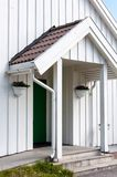 White wooden traditional architecture in Norway on May 20, 2014 in Gardermoen, Norway Royalty Free Stock Images