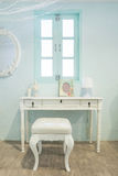 White wooden vanity table with window in background Stock Photography