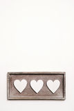 White wooden vintage background with three hearts. Royalty Free Stock Photo