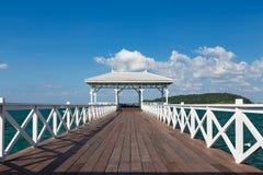 White wooden walkway leading to seacoast skyline Royalty Free Stock Image