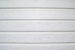 White wooden wall background, rustic panels outdoors. stock photos