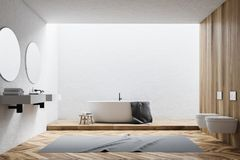 White and wooden bathroom interior. White and wooden wall bathroom interior with a white tub, a double sink and two round mirrors. Toilets. 3d rendering mock up Royalty Free Stock Photos