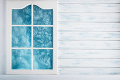 White wooden wall and a frosted window Stock Photo