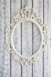 White wooden wall with vintage frame. Background Stock Photo